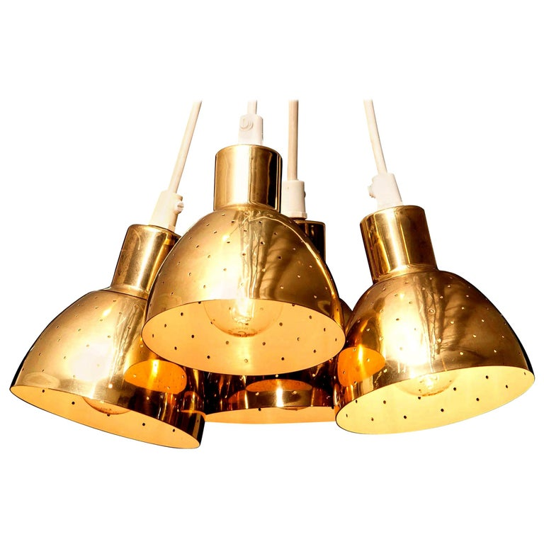 Great set of four brass pendants by Hans-Agne Jakobsson for Markaryd, Sweden.