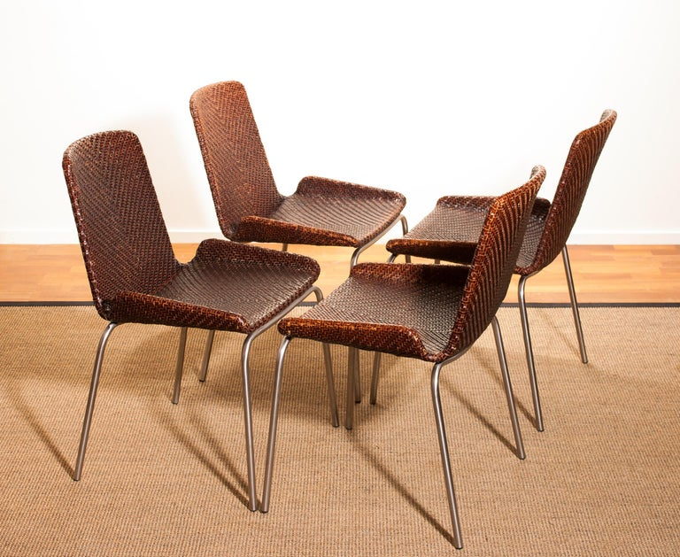 An amazing set of four dining chairs made in Italy. These chairs have a brown leather braided seating and backrest on a steel frame. They are in wonderful condition. Period 1960s Dimensions: H 84 cm, W 51 cm, D 45 cm, SH 46 cm.