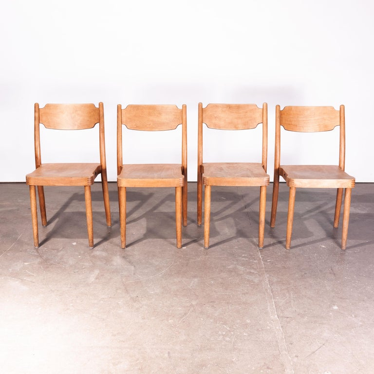1960s vintage set of four chairs in the style of Peter Hvidt Portex dining or side chairs. Peter Hvidt was a well known Danish architect and designer who was fascinated by the use of plywood in production. This is a set of four stacking dining