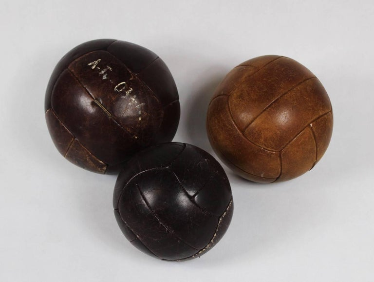 Set of three leather gym balls from the 1960s. 