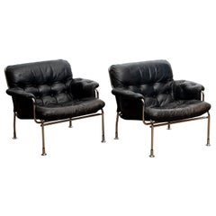 1960s Set of Two Eva Lounge Chairs in Chrome and Aged Black Leather by Lindlöfs