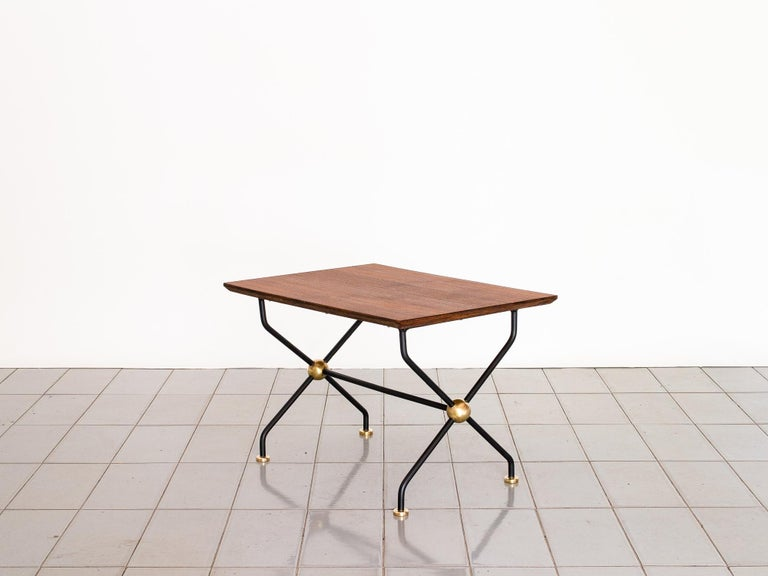 Beautiful petite side table with wrought iron structure and amazing brass spheres. The top is veneered in oil treated Asian Teak.