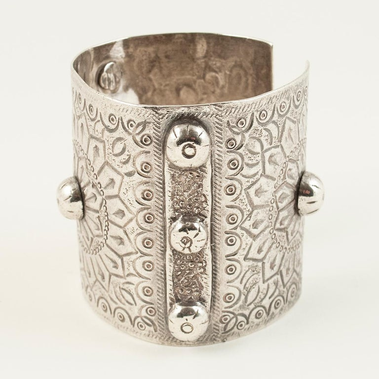 1960s silver tribal cuff, Siwa Oasis, Egypt  A traditional cuff from Siwa Oasis with a sun motif. The three part silver hallmark indicates, from left to right: a purity of 800, the lotus, which is used for all pieces made after 1946, and the Arabic