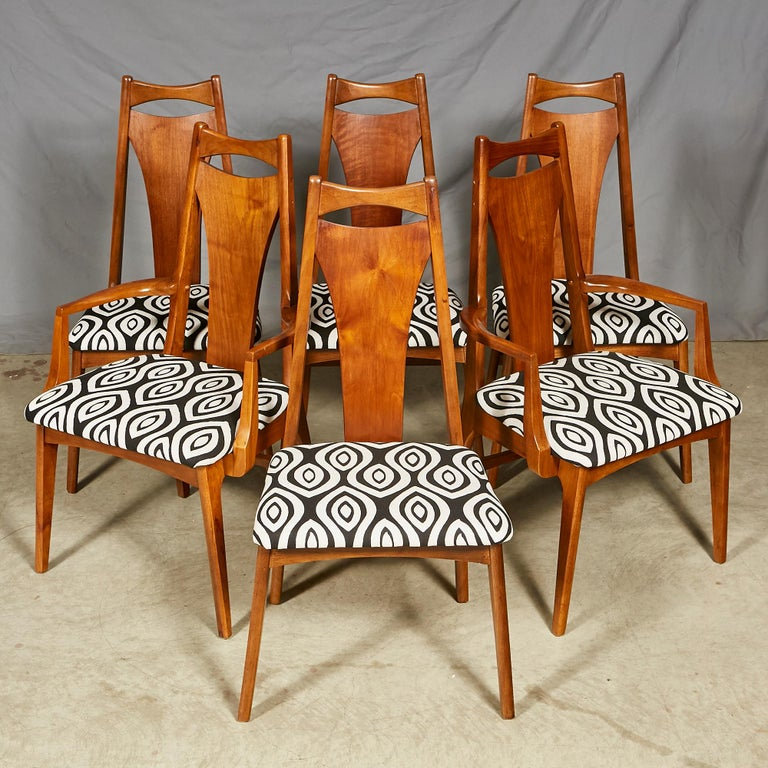Vintage 1960s set of six solid walnut high back dining room chairs. The set has two armchairs. Seat, 20in.H. Arm, 25in.H. Excellent condition. No maker's mark.
