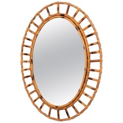 1960s Spanish Mediterranean Style Rattan and Bamboo Oval Sunburst Mirror