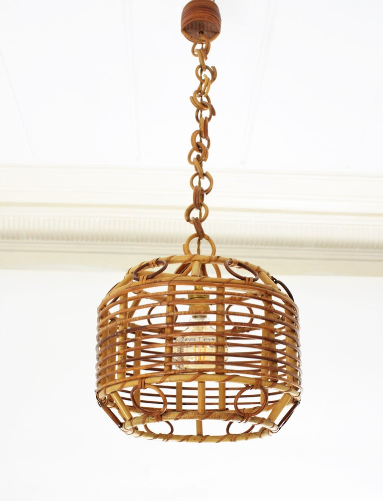 A beautiful handcrafted rattan, wicker and bamboo pendant light or lantern with geometric decorations, Spain, 1960s.  It hangs from a wicker chain that can be modified to make it shorter. This lamp could add a fresh Mediterranean taste over a