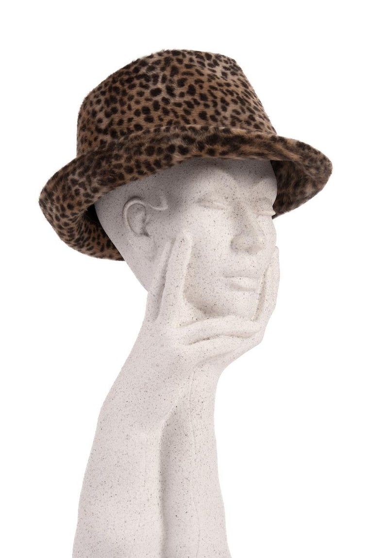 This is an ultra-stylish cheetah animal print fedora hat from the 1960s.  Make a statement with this animal print fedora hat. The brimmed design is crafted from a soft fur felt showcasing the characteristic black cheetah spots on a caramel