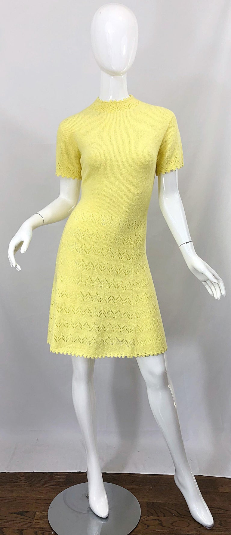 Tres chic ST. JOHN signature santana knit canary yellow short sleeve A-Line dress! Features the softest knit that stretches to fit. Hand crochet detail at the neck, sleeves and below the waist. Full metal zipper up the back with hook-and-eye