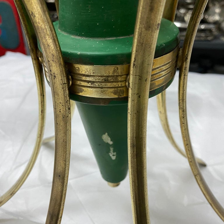 A six lights chandelier manufactured in the style of Stilnovo in the Sixties, brass it's in original patina, green painted metal is in good conditions, the white opaline diffusors are in perfect conditions, it works 110-240 volts and needs six