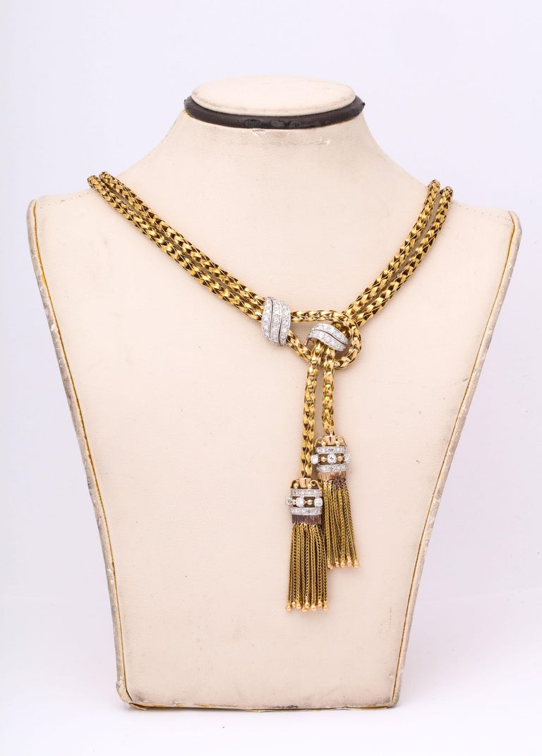 One 18kt Yellow Gold Stylish And Chic Suite Including A 16 Inch Long Necklace With Tassels Embellished With 2 Carats Of Diamonds Weight Of Necklace= 60 Grams Approximately And Included In Suite Is A Bracelet Measuring 6.5 Inches And Embellished With