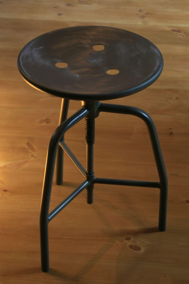 A classic swivel medical stool with adjustable seat height. Production: 1960s.  Construction: Welded steel construction, pressed sheet steel seat, height adjustment - threaded seat post.  Range of renovation: The stool was sandblasted, the upper