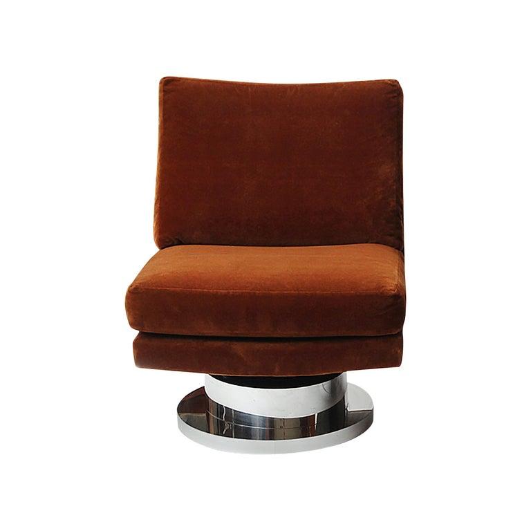 A slipper chair on a chromed swivel base, retaining the original russet, cut velvet upholstery. Designed by Milo Baughman for Thayer-Coggin.