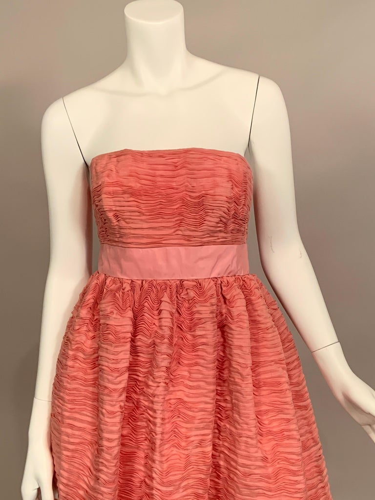 Sybil Connolly is most famous for her extremely rare pleated linen clothing.  This strapless pink gown is a stunning example of these pleated designs.  They are made from handkerchief linen which is hand dyed and then pleated.  It takes nine yards