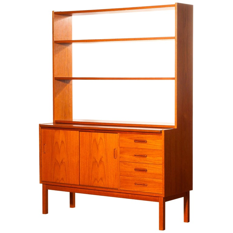 Very beautiful bookcase with slidable writing space produced in Sweden.