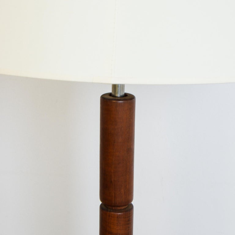 A hardwood lamp base from Denmark, circa 1960. Influenced by mid-20th century Danish modern furniture style, this lamp has a striking geometric profile, with modular elements carved from durable teak. Scandinavian style electrified, with updated