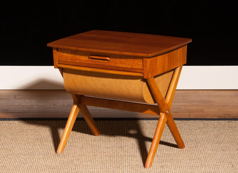 Very nice sewing table made in Sweden. This table is made of teak and has one normal drawer and one deep drawer. It is in a beautiful condition. Period 1960s. Dimensions: H 52 cm, W 52 cm, D 45 cm.