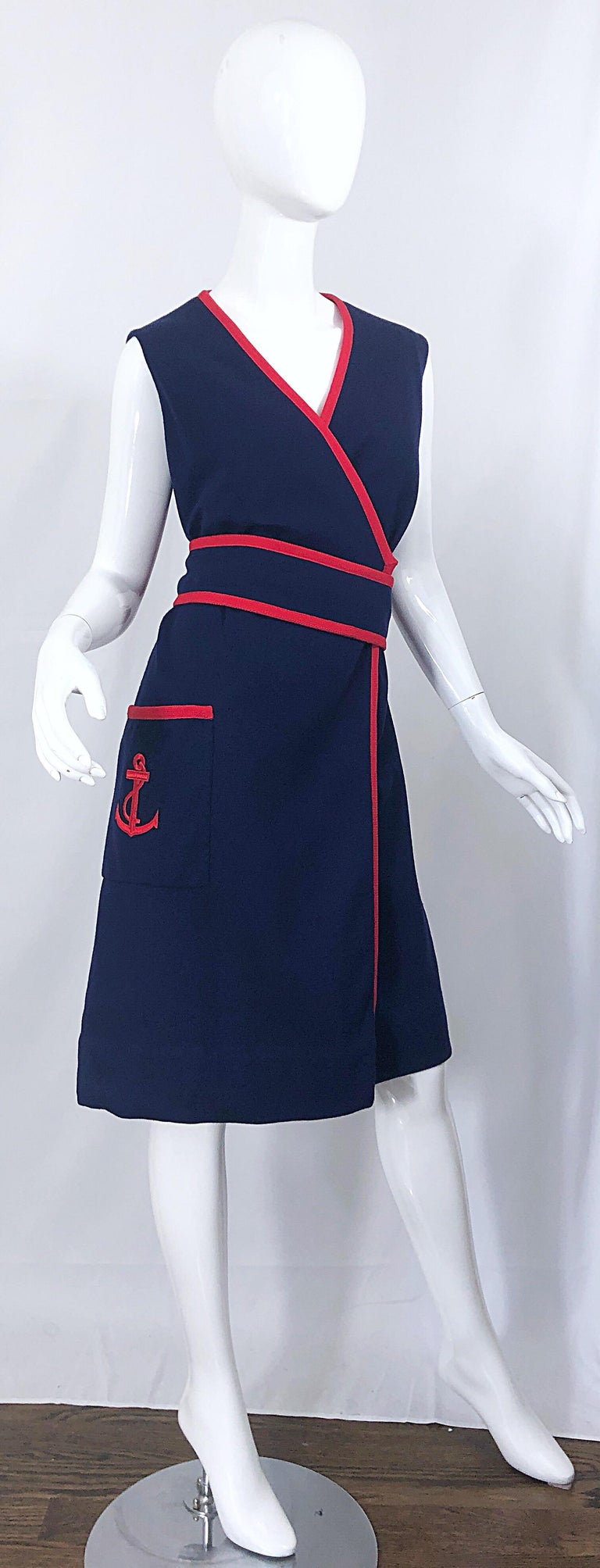 Chic 1960s TEAL TRAINA larger size navy blue and red nautical 'anchor' belted wool wrap dress!   Features a soft navy blue virgin wool with red accents. Red anchor embroidered at the left hip pocket. Interior side button closure, with hook-and-eye