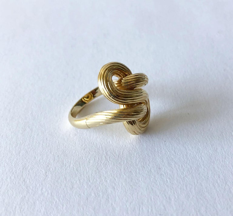 Florentined 14K gold knot ring, circa 1960's.  Ring is a finger size 8.5 - 9 and is signed 14K.  In very good vintage condition.  10.4 grams.