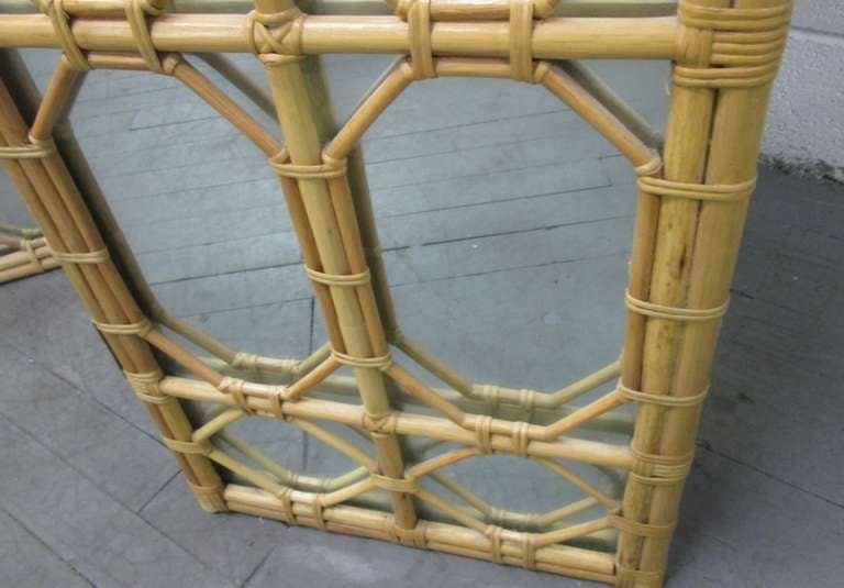 Decorative, three-panel rattan floor screen or room divider. It has octagonal and diamond shapes to the front of the mirror. Style of Paul Frankl.  Measures: 88