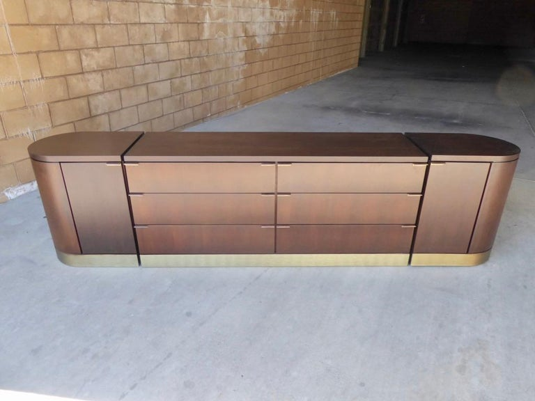 This is a handsome, sleek and Classic very unusual, even rare, three-part credenza by Milo Baughman for Glenn of California., circa 1960s. The overall length is 110