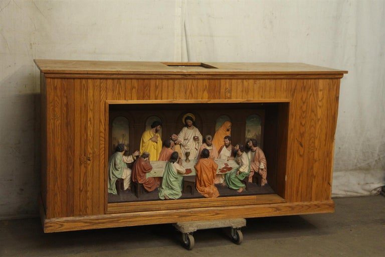 1960s medium wood tone altar piece with highly detailed the last supper in the front centre. Recovered from a site in NYC. Very unique as it shows Judas walking out preparing to betray Jesus. The back side has shelves and openings with a florescent