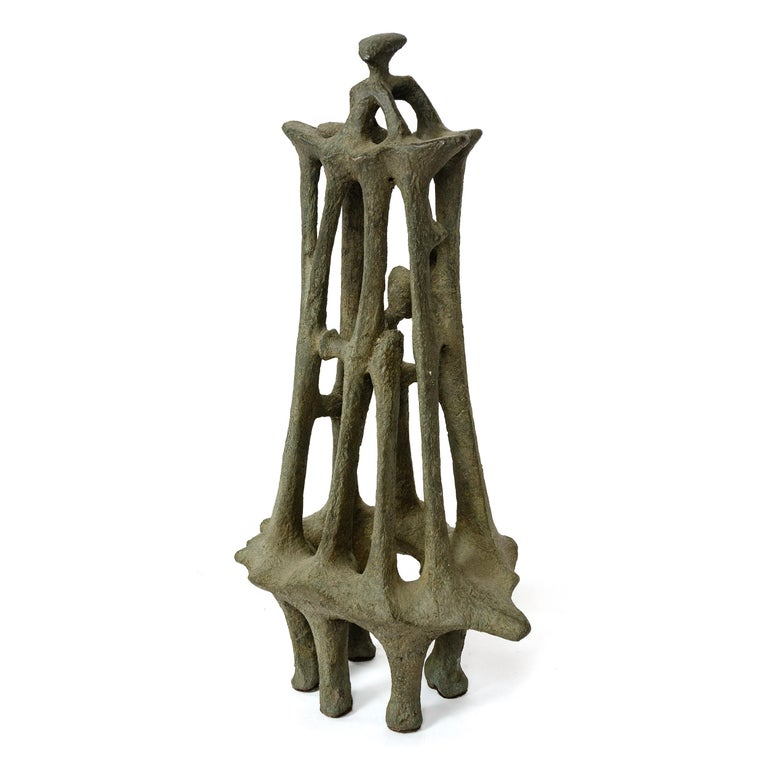 An unsigned vintage cast bronze abstract sculpture with natural patina.