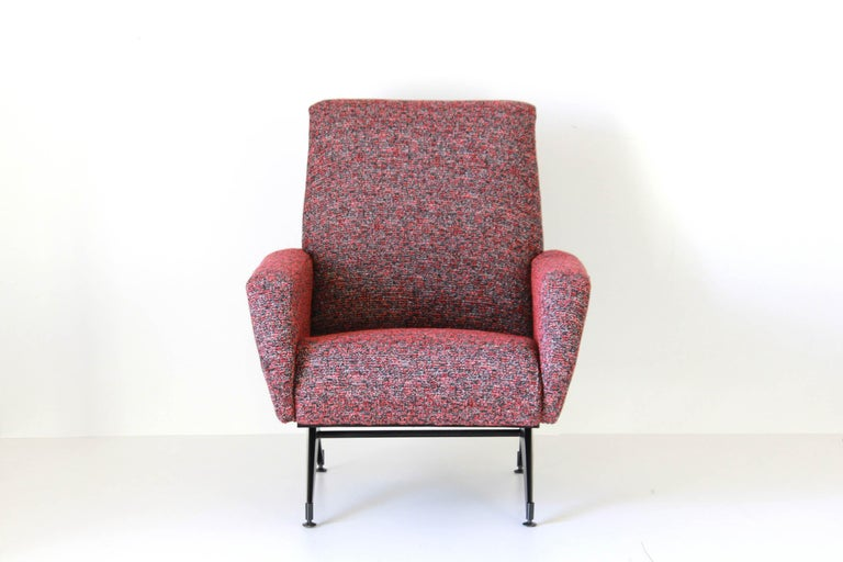 A 1960s vintage armchair with iron base and filled seat. Multicolor viscose cover. Fully renovated item. The base has been reapainted, whilist the seat has been reupholstered and added with a new viscose cover. Small brass feet at the base. In very