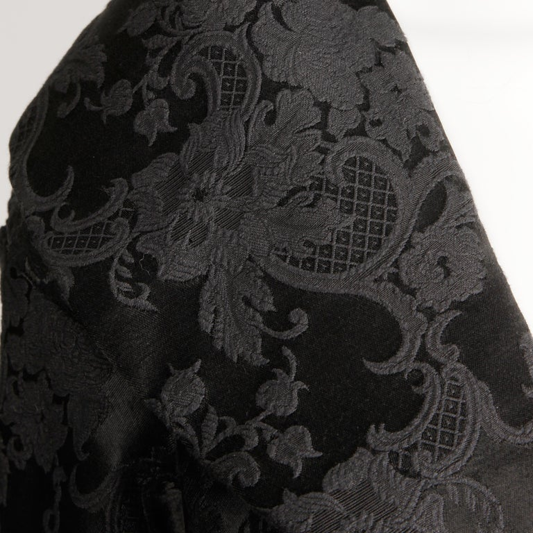 Chic vintage 1960s black damask evening coat with cropped 3/4 length sleeves and a pop up collar. Fully lined with no closure (hangs open). Fits a petite small-medium. This has a junior label but will look great on most petite ladies sizes