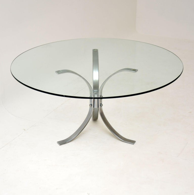 A beautifully designed vintage coffee table from the 1960s-1970s. This has a top quality chrome frame, with a loose circular glass top. The condition is excellent for its age, the frame has only some light surface wear. The glass is also in