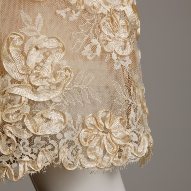 Stunning vintage two-piece ensemble featuring a top and a skirt that can be worn together as a dress or separately. This came from a high end estate and was custom made for it's original owner with silk and soutache lace fabric that she brought back