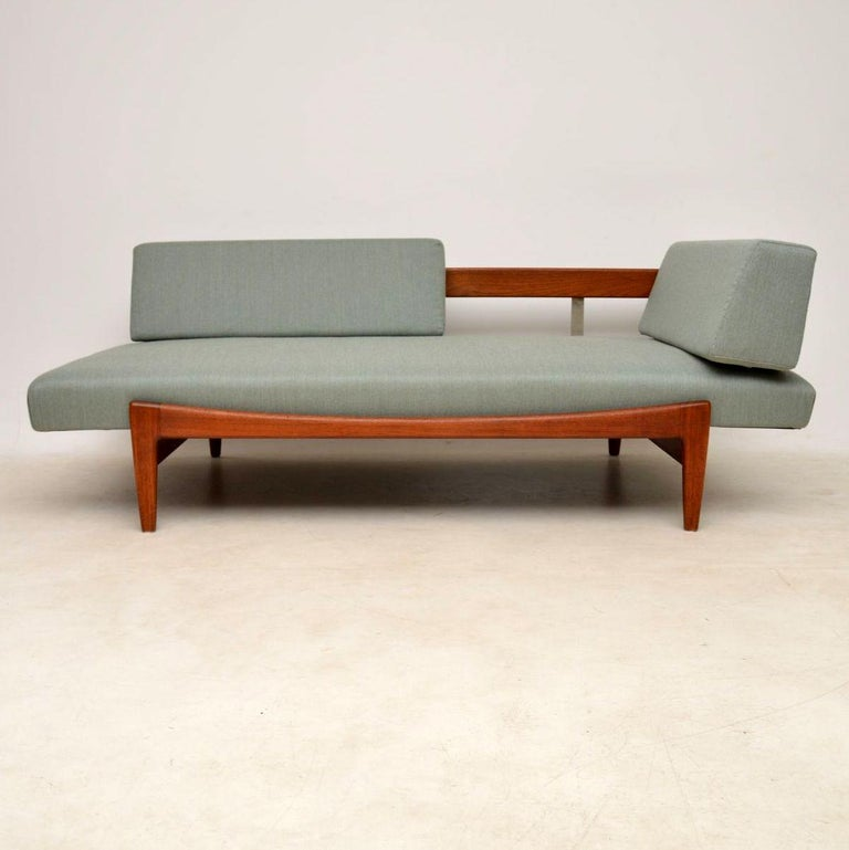 A magnificent vintage sofa/daybed in solid teak, this was designed by the famous Danish designer IB Kofod Larsen, it was made in Sweden by Seffle Mobelfabrik in the 1960s. You can see how beautiful this is from the photos, but they still don't fully