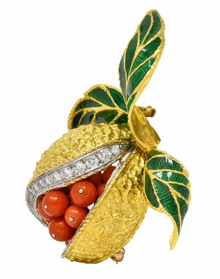 Brooch is designed as a stylized and deeply textured gold pomegranate, split down the front, revealing a cluster of coral seeds  Round cut coral beads are very well-matched with strongly reddish-orange color, measuring from 5.5 mm to 4.2 mm  With