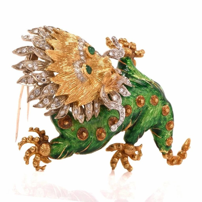 This whimsical dragon diamond enamel brooch pin  is crafted in solid 18K yellow and white gold.  Dragon Head adorned with some 106 genuine bead-set round cut diamonds weighing approximately 2.35 carats, graded G-H color and VS1-VS2 clarity.  The