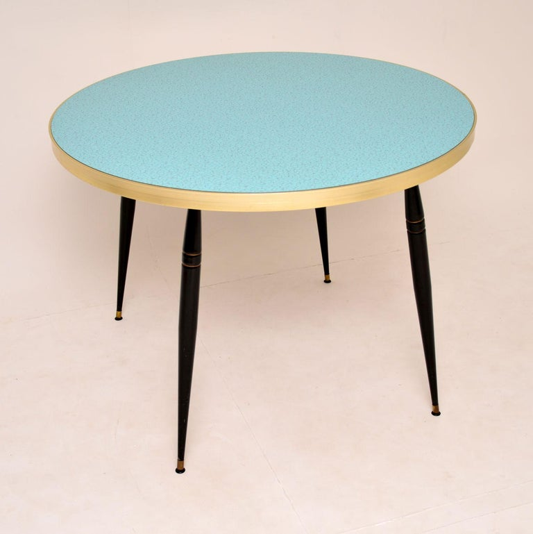 A stunning vintage circular dining table from the 1960s. This is one of the nicest examples we've ever seen. It is very bold and stylish, top quality as well.