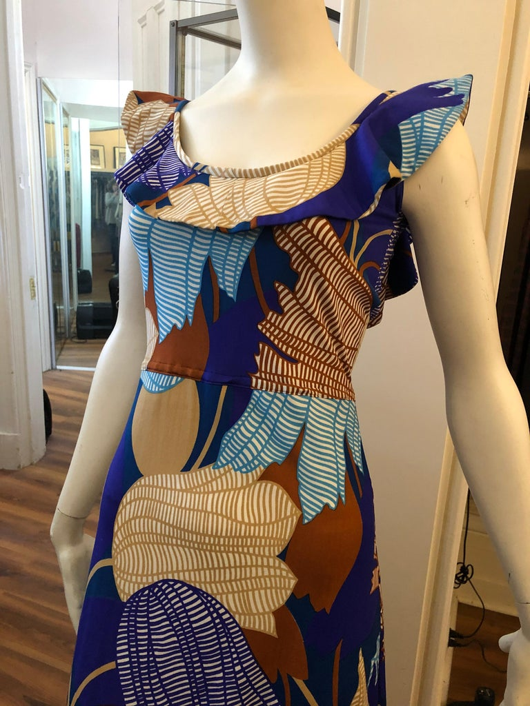 Very nice Lanvin tulip print dress designed by Belgian born Jules-Francois Crahay with a frilly collar which extends to a slightly lower back drop. Can be worn as a sun dress or accessorize and wear to any event. There is a hidden center back hidden