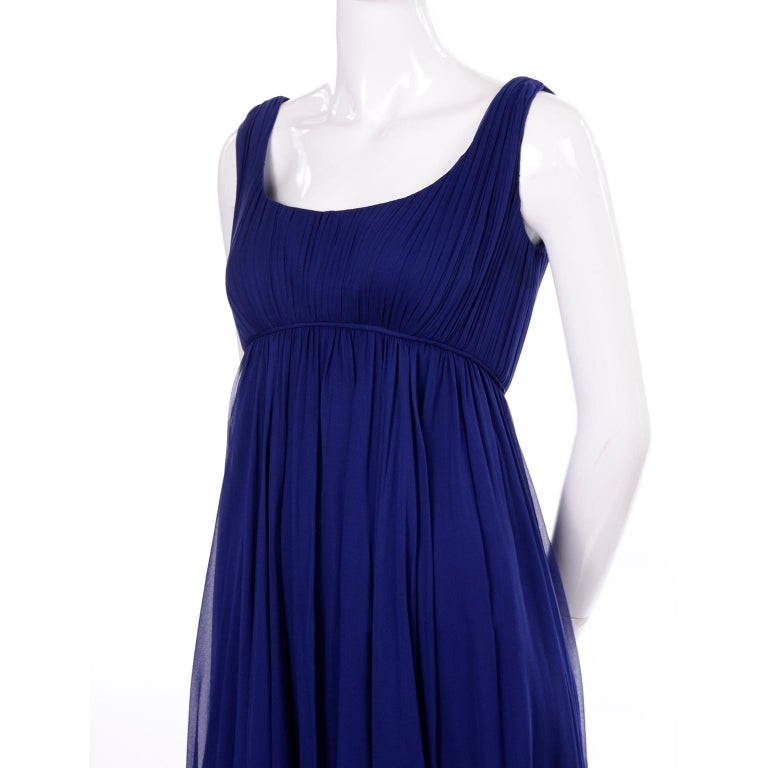 This is a lovely vintage dress designed by Malcolm Starr in the 1960's. The dress is in a beautiful shade of blue silk chiffon and has a low back and empire waist. Malcolm Starr's designs were worn by prominent women in the 1960's and 1970's.  His