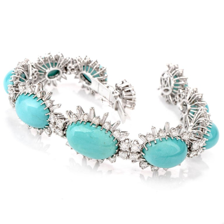 This beautiful vintage 1960's Persian Turquoise bracelet was inspired in a starburst motif  and crafted in 18 Karat white gold.  Cnetered in each link are tapering pieces of oval shaped Turquoise  ranging from 18.5 x 13.5mm to 11.87 x 8.80mm,