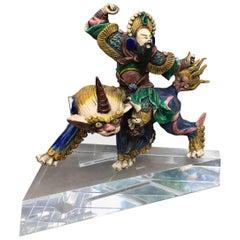 Asian Statue on Lucite Pedestal Samuri Riding Foo Dog