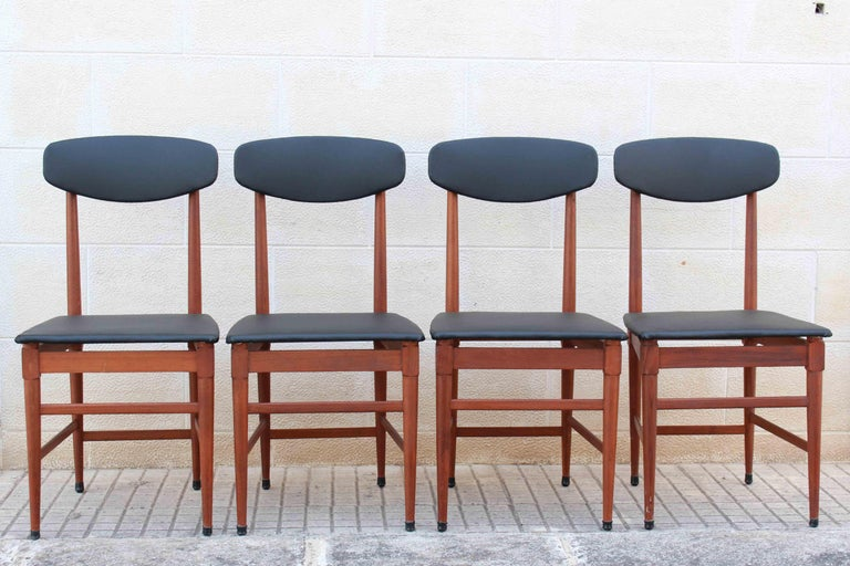 Four leatherette and wood dining chairs from the 1960s. The filling as well as the skai cover have been changed with brand new ones. Wood structure has been polished and cleaned. In excellent conditions with only few signs of the time.