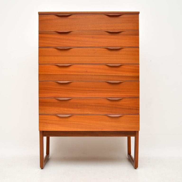 A stylish and very well made chest of drawers in teak, this dates from the 1960's. It has a beautiful design, with lots of storage space, the legs are detachable for ease of transport. We have had this completely stripped and re-polished to a very