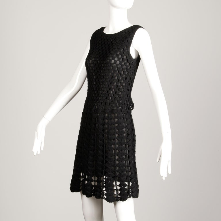 Vintage 1960s vintage black hand crochet dress with lining. Fully lined with no closure (pulls on over the head) tie belt at waist woven into the fabric may be removed if desired. The marked size is small, but the dress will also likely fit a modern