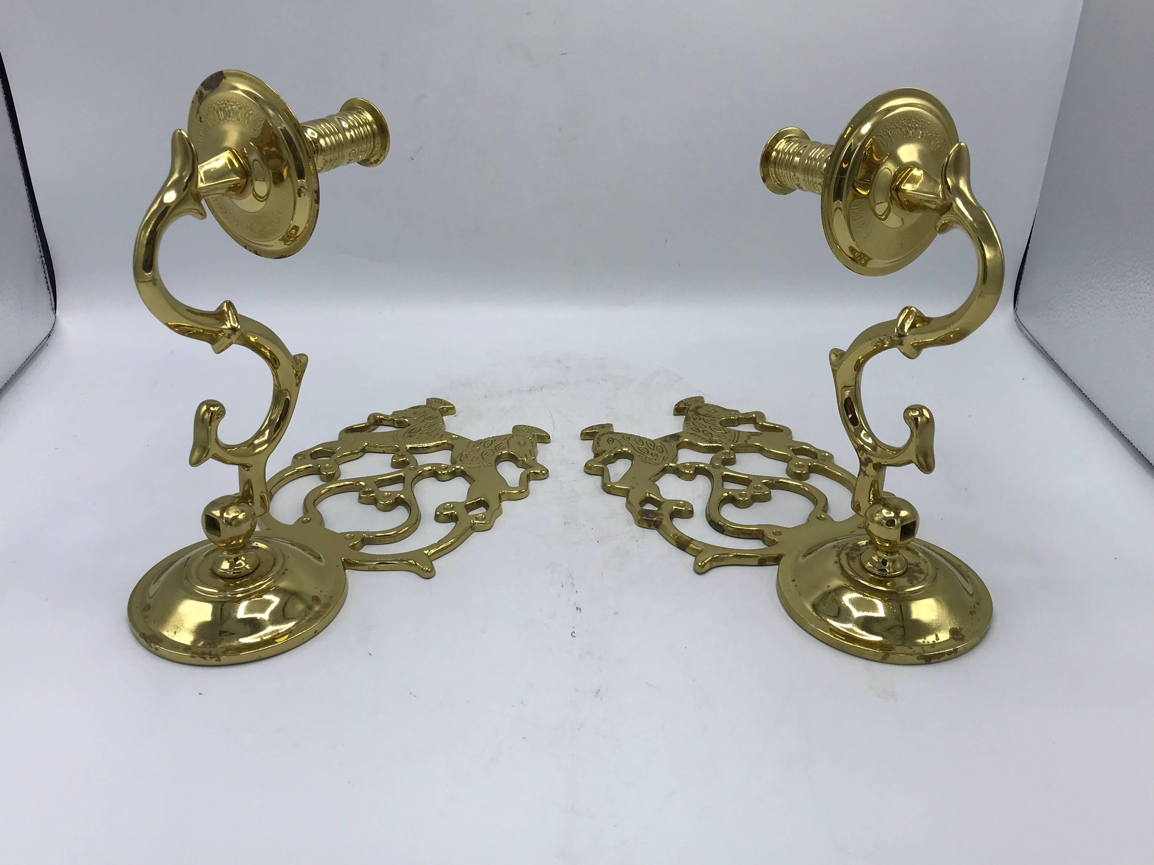 1960s Virginia Metalcrafters Single Arm Candle Sconces With Crest Motif Pair At 1stdibs