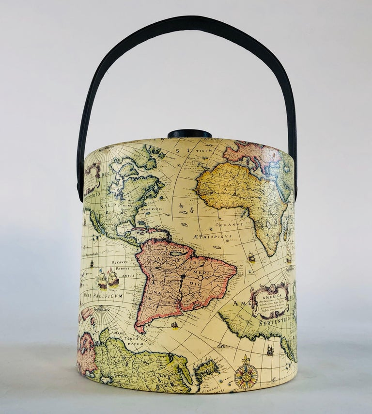 Vintage 1960s world globe style vinyl ice bucket with a wood knob. Excellent condition. Marked underneath.