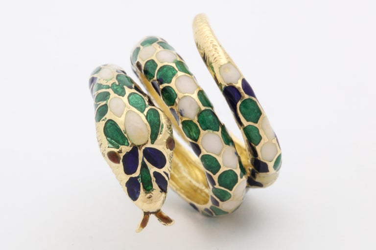One Ladies Cocktail Ring Designed With Blue,Green And White Hard Enamel Pattern In A Shape Of A Snake. Beautiful Wrap Around Coil Effect To Emulate A Snakes Full Body. Created In 18kt Yellow Gold Ring Fits Size 7 - 7.5 Ring Size.Made In The 1960's