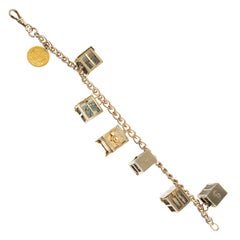 1960s Yellow Gold Mad-Money Themed Charm Bracelet