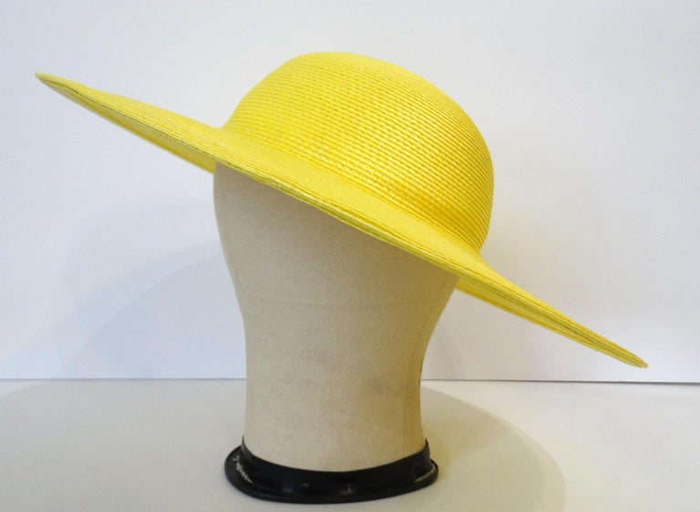 Channel Your Inner French Lady With This Parisian Style Hat! Circa 1960s, this bright yellow straw hat features a classic bowler style top and a wide brim. Perfect for your next getaway or brunch!