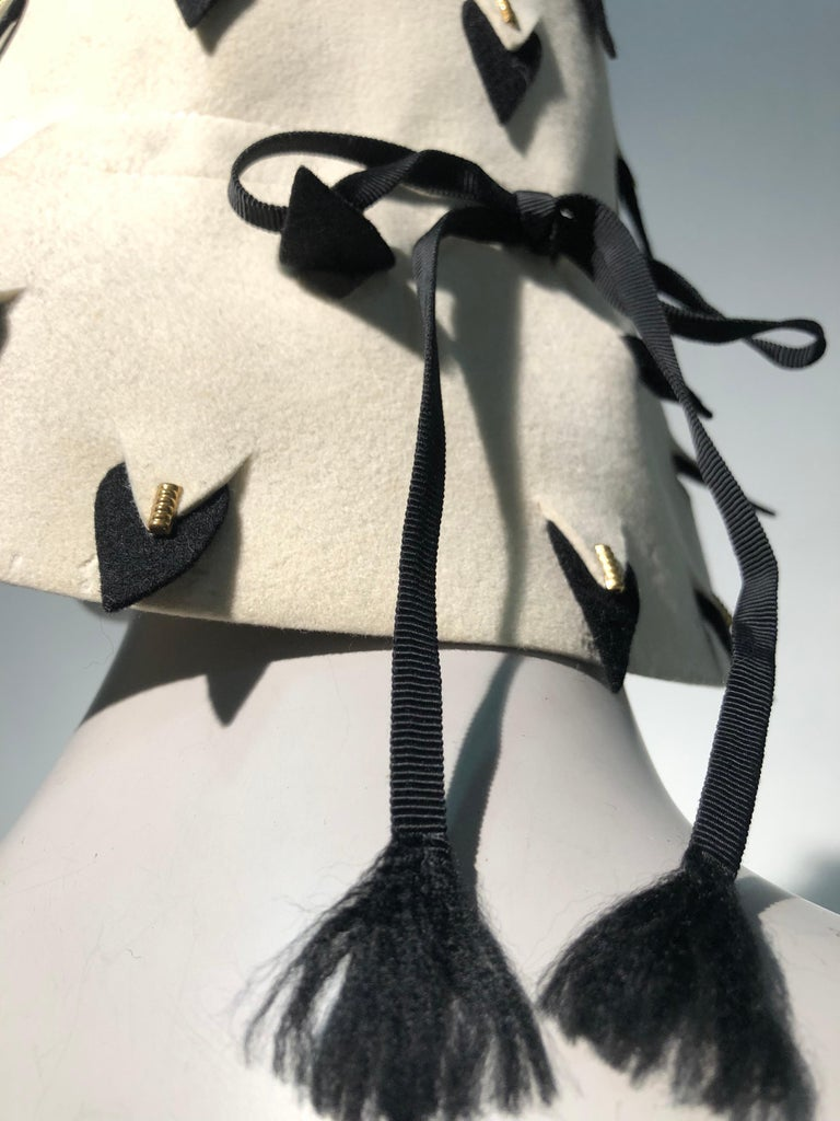 e745593a353ce A smart 1960s Yves Saint Laurent eggshell wool felt bucket hat with graphic  black and white