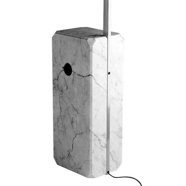 Vintage edition of 1970s  The Arco is a design icon that has been in constant production since its debut in 1962.   Carrara marble base with beveled corners and a strategic hole that allows for easy lifting of the base. The base supports a spun