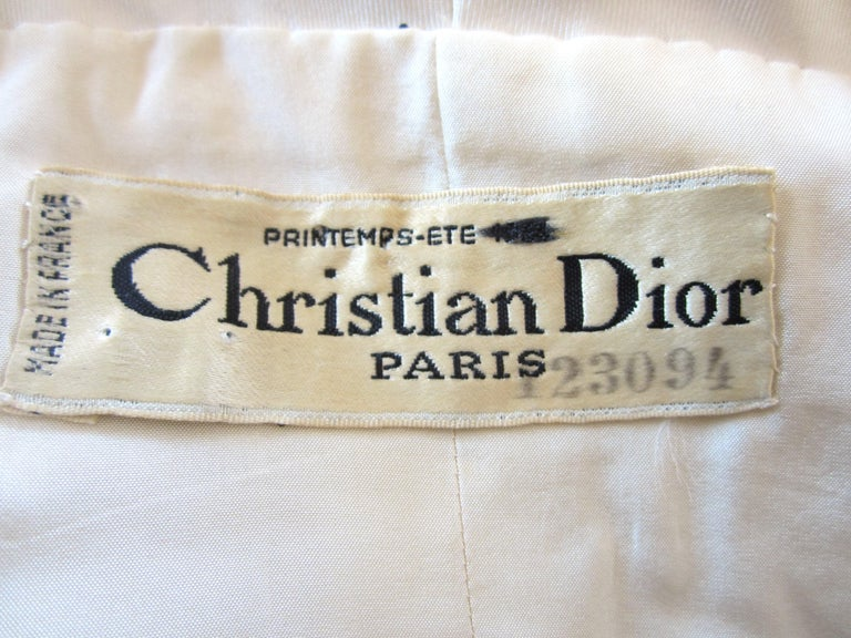 The detailing on this is outstanding! Boned bodice. Christian Dior Printemps- ETE- 1964. Numbered. Silky hand to the fabric. Weighed on the skirt, bodice and jack. Clip and snap closure on the dress. Jacket has a hook and eye and 2 button closure.