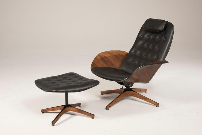 1964 Mr. Chair II by George Mulhauser for Plycraft and Ottoman Swivel and tilting chair, Original Black leather seats and cushion. Original sticker is present. Excellent good conditions. A video is available upon request. Size or armchair: W